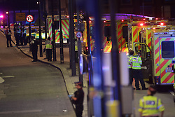 """Emergency personnel on London Bridge as police are dealing with a """"major incident"""" at London Bridge."""