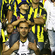 Fenerbahce's supporter and his child during their Turkish Super Cup 2012 soccer derby match Galatasaray between Fenerbahce at the Kazim Karabekir stadium in Erzurum Turkey on Sunday, 12 August 2012. Photo by TURKPIX