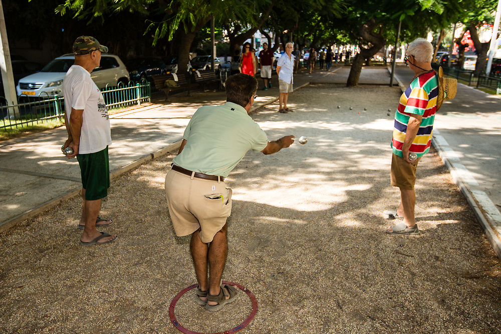 French tourists play Petanque (or Petang) on Rothschild Boulevard in Tel Aviv's Lev Hair neighborhood