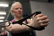 Partially-sighted skiing paralympian from the Sochi Olympics, Kelly Gallagher trains in the gym at the Sports Institute, University of Ulster, Northern Ireland, UK. Handling weightted pulleys she starts a new training regime for the forthcoming winter season. Kelly Marie Gallagher, MBE is a Northern Irish skier and the first athlete from Northern Ireland to compete in the Winter Paralympics. Gallagher won Britain's first ever Winter Paralympic gold medal during Sochi 2014.