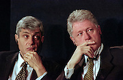 US President Bill Clinton (R) and US Treasury Secretary Robert Rubin listen during the opening session of the International Monetary Fund World Bank annual meeting October 6, 1998 in Washington, DC.