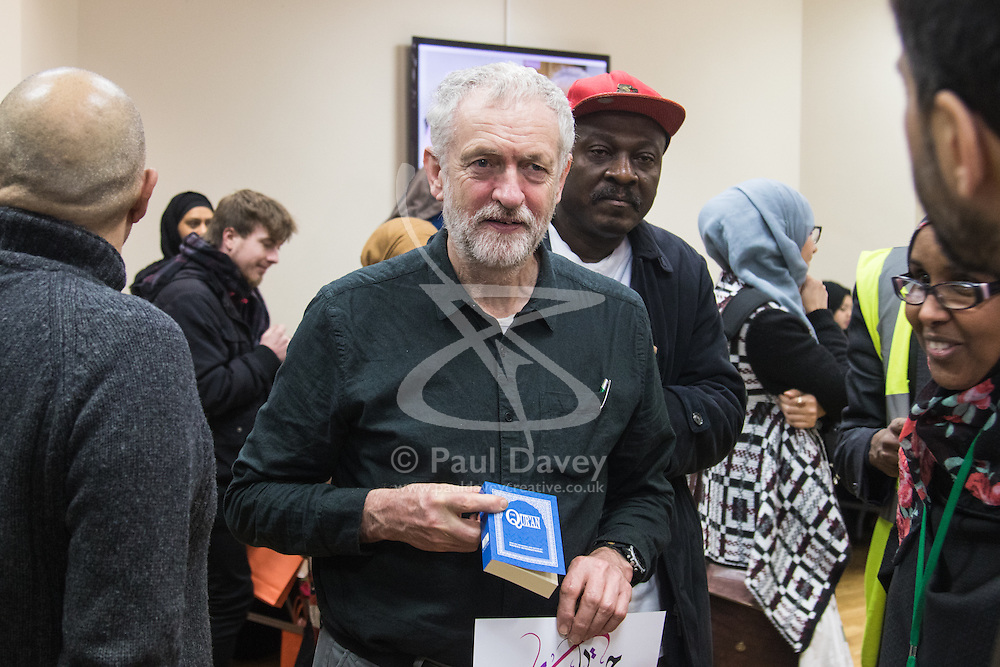 """Finsbury Park Mosque, London, February 7th 2016. Labour leader and local MP Jeremy Corbyn holds an English copy of the Qur'an during a visit to Finsbury Park Mosque as part of a Visit My Mosque initiative by the Muslim Council of Britain to show non-Muslims """"how Muslims connect to God, connect to communities and to neighbours around them"""".<br /> . ///FOR LICENCING CONTACT: paul@pauldaveycreative.co.uk TEL:+44 (0) 7966 016 296 or +44 (0) 20 8969 6875. ©2015 Paul R Davey. All rights reserved."""