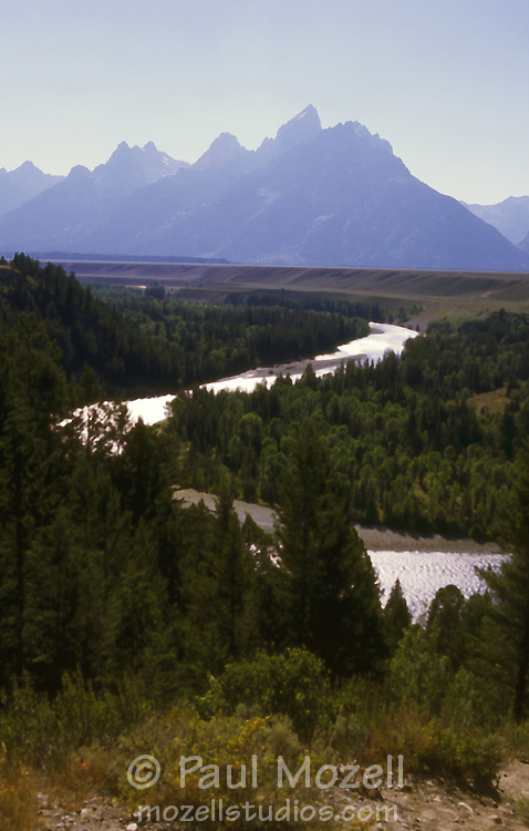 "The Snake River winds toward ""The Grand Teton"" from the location where Ansel Adams took his famous photograph"