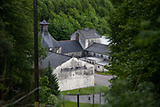 The distillery Glendullan lies surrounded by trees and hills in Dufftown in the Scottish Highlands.