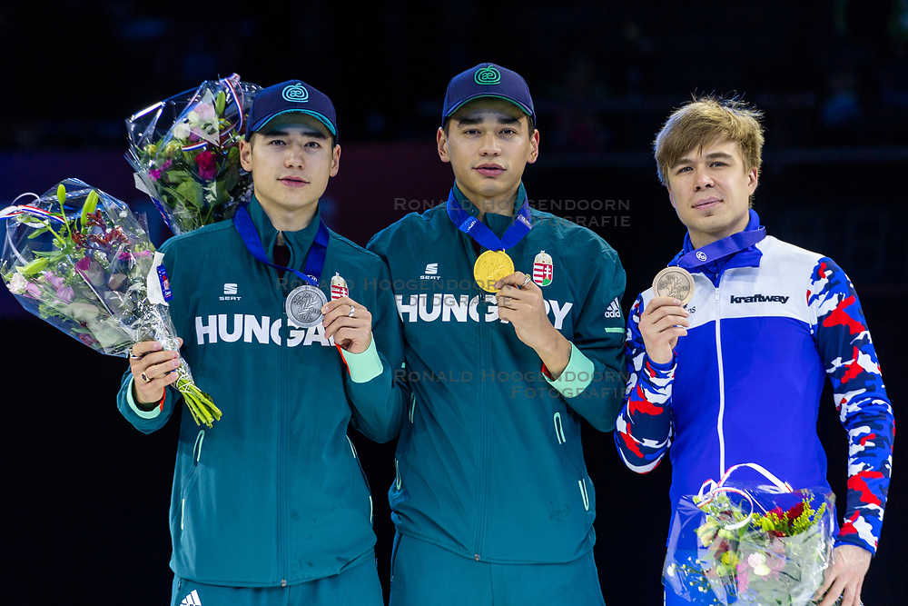 12-01-2019 NED: ISU European Short Track Championships 2019 day 2, Dordrecht<br /> (L-R) Shaoang Liu and Shaolin Sandor Liu of Hungary and Semen Elistratov of Russia pose in the Men's 1500m medal ceremony during the ISU European Short Track Speed Skating Championships