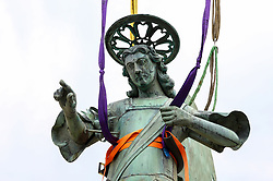 After two months of restoration, the Archangel Michael's statue, made of copper plate, returned to Piran. The image shows a view of the statue of Archangel Michael before helicopter placing it on top of the church's clock, on October 15, 2018 in Piran, Slovenia. Photo by Matic Klansek Velej / Sportida