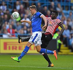 Carlisle United's Richard Bennett battles with Sunderland's Papy Djilobodji