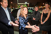 """11 DECEMBER 2011 - SCOTTSDALE, AZ:    Congresswoman and Republican Presidential hopeful MICHELE BACHMANN (center) arrives for a fundraiser sponsored by Politics on the Rocks at the Mint in Scottsdale Sunday. The Mint is a popular bar and restaurant built in a former bank in Scottsdale, AZ. Politics on the Rocks was started by Charles A. Jensen in Scottsdale, Arizona. The purpose of """"Politics on the Rocks"""" is to bring Republican & Conservative Professionals together in a monthly happy hour where they can network, socialize, and hear directly from prominent politicians and successful business leaders.    PHOTO BY JACK KURTZ"""