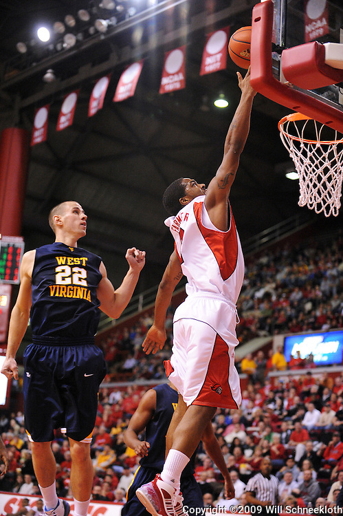 Feb 22, 2009; Piscataway, NJ, USA; Rutgers guard Anthony Farmer (2) puts up a layup past the defense of West Virginia guard Alex Ruoff (22) during the first half of Rutgers' 74-56 loss to West Virginia at the Louis Brown Athletic Center.
