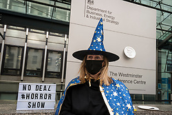 © Licensed to London News Pictures. 28/10/2020. LONDON, UK.  An anti-Brexit protester from SODEM at a Halloween-themed demonstration outside the Department for Business, Energy & Industrial Strategy in Westminster.  Michel Barnier, the European Commission's Head of Task Force for Relations with the United Kingdom, is attending meetings inside.  Photo credit: Stephen Chung/LNP