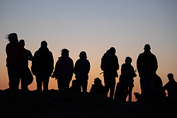 © Licensed to London News Pictures. 21/04/2019. Worcester, UK. Crowds gather at the Worcestershire Beacon before a religious service at sunrise on Easter Sunday. The Beacon is the highest point in the Malvern Hills at 425m. Easter Sunday is a key date in the Christian calendar. Photo credit : Tom Nicholson/LNP