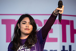London, UK. 19 October, 2019. Erica Ramos, Vice-President of the National Union of Students (NUS), addresses hundreds of thousands of pro-EU citizens at a Together for the Final Say People's Vote rally in Parliament Square as MPs meet in a 'super Saturday' Commons session, the first such sitting since the Falklands conflict, to vote, subject to the Sir Oliver Letwin amendment, on the Brexit deal negotiated by Prime Minister Boris Johnson with the European Union.