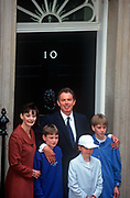 The newly-elected British Labour Prime Minister Tony Blair stands on the steps of Number 10 Downing Street with his wife Cherie and three children Euan; Kathryn and Nicky, the morning after his landslide election victory over the Conservative John Major, on 2nd May 1997, in Westminster, England.