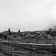 Two men stands in the middle of rocks in a field of Sapa, Vietnam.2005