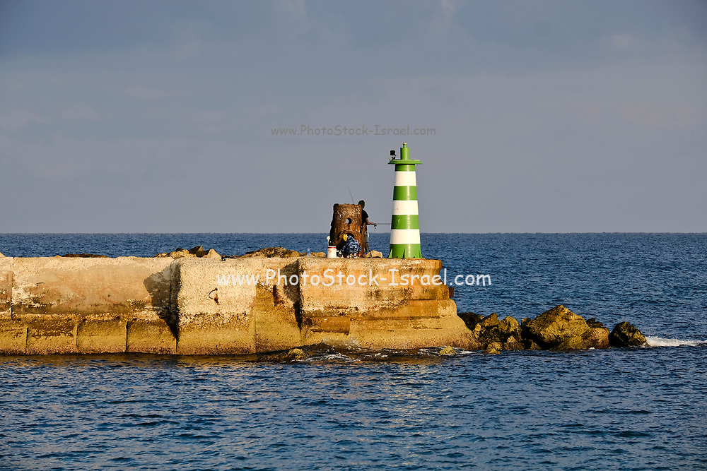 The green lighthouse at the entrance to the historic port of Jaffa, Israel