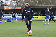 AFC Wimbledon midfielder Dylan Connolly (16) warming up during the EFL Sky Bet League 1 match between AFC Wimbledon and Barnsley at the Cherry Red Records Stadium, Kingston, England on 19 January 2019.