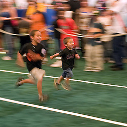 Two young fans race inside the 2007 DHL All-Star FanFest, Saturday, July 7 at Moscone Center West in San Francisco...Photo by David Calvert/MLB.com