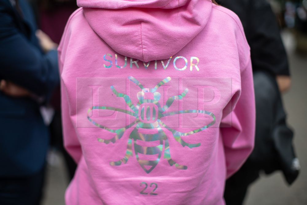 """© Licensed to London News Pictures . 22/05/2019. Manchester, UK . A woman wearing a hoodie with the word """" Survivor """" and the number 22 on the reverse . People in St Ann's Square in Manchester City Centre on the second anniversary of the Manchester Arena bombing following a private service in St Ann's Church . On the evening of 22nd May 2017 , Salman Abedi murdered 22 people and seriously injured dozens more , when he exploded a bomb in the foyer of the Manchester Arena as concert-goers were leaving an Ariana Grande gig . Photo credit: Joel Goodman/LNP"""