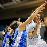 020415  Adron Gardner/Independent<br /> <br /> Window Rock Scout Alicia Hale (25), right, pulls down a rebound away from the Hopi Bruins at the Fighting Scout Event Center in Fort Defiance Wednesday.