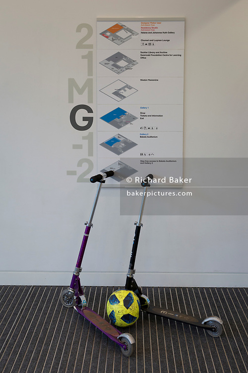 A football and two scooters lean against a floor plan of Kensington's Design Museum, on 6th January, in London, England.