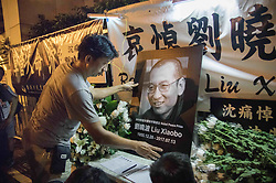 July 13, 2017 - Hong Kong, China - Residents of Hong Kong host a vigil service outside the Chinese Liason Office of Hong Kong after the death of Human Right Activist and Nobel Peace Prize Winner Liu Xiaobo. Liu Xiaobo has been in prison by the Chinese authority since 2008 for charges made against him for ''suspicion of inciting subversion of state power. (Credit Image: © Geovien So via ZUMA Wire)