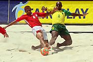 Football - FIFA Beach Soccer World Cup 2006 - Final - BRA X URU - Rio de Janeiro - Brazil 12/11/2006<br />Coco (URU) fights for the ball with Junior Negao (BRA) during the match Event Title Board Mandatory Credit: FIFA / Ricardo Moraes