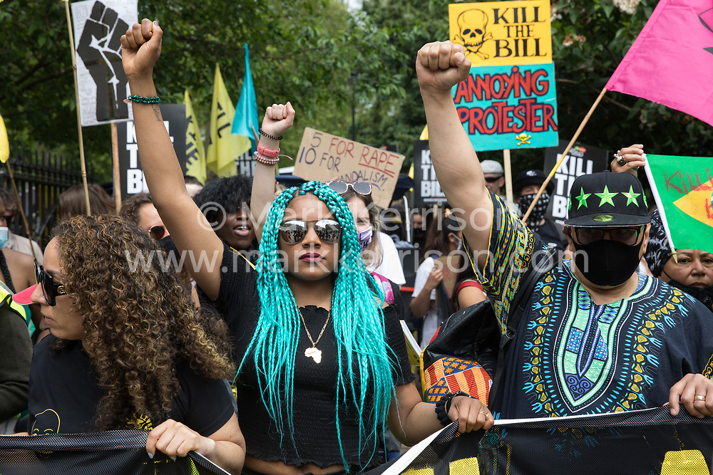 Chantelle Lunt (l) and Lee Jasper (r) take part in a Kill The Bill National Day of Action in protest against the Police, Crime, Sentencing and Courts (PCSC) Bill 2021 on 29th May 2021 in London, United Kingdom. The PCSC Bill would grant the police a range of new discretionary powers to shut down protests, including the ability to impose conditions on any protest deemed to be disruptive to the local community, wider stop and search powers and sentences of up to 10 years in prison for damaging memorials.