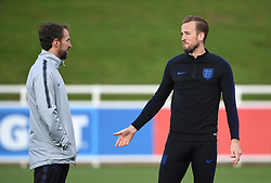 England manager Gareth Southgate (left) and captain Harry Kane during the training session at St George's Park, Burton.