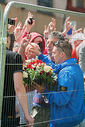 The English Defence League (EDL) return to Sheffield to lay flowers at Sheffield War Memorial which is fenced off to stop counter protesters occupying the whole of Barkers Pool. EDL leader Tommy Robinson prepares to lay flowers a the Sheffileld War Memorial<br /> <br /> 8 June 2013<br /> Image © Paul David Drabble<br /> www.pauldaviddrabble.co.uk