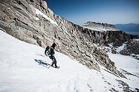 Hiker Descends snowy chute on Mountaineers Route of Mount Whitney, Sierra Nevada Mountains, California