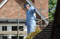 © Licensed to London News Pictures. 21/05/2015<br /> A police officer searching the roof.<br /> Met police search teams arriving early this morning (21.05.2015) at the Dartford home of Brian and Paul Reader.<br /> Eight men, including two from Kent, have been charged in connection with the multimillion pound jewellery heist at Hatton Garden.<br /> <br />  Brian Reader and his son Paul Reader both of Dartford Road, Dartford,Kent have been charged with conspiracy to burgle.  <br /> <br />  <br /> (Byline:Grant Falvey/LNP)