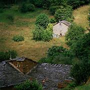 Farm buidlings in rural countryside near the village of Boal, Asturias, Spain
