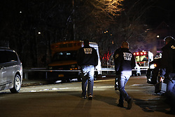 A police officer was shot in the stomach and a knife-wielding suspect was shot and killed when cops opened fire while responding to a domestic dispute on Staten Island Sunday night. **NO NEW YORK DAILY NEWS, NO NEW YORK TIMES, NO NEWSDAY**. 09 Dec 2018 Pictured: Police search a rear yard at the scene of a cop shot in Staten Island. Photo credit: William C. Lopez/NY Post/MEGA TheMegaAgency.com +1 888 505 6342