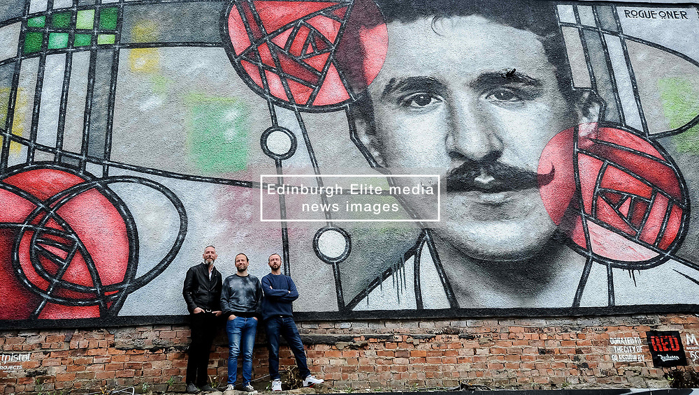 Pictured: Raddisson RED curator Michael Weston (left), Art Pistols Projects founder Ali Smith (middle) and artist Bob McNamara aka Rogue One with the mural.<br /> <br /> A giant street mural, inspired by the work of Charles Rennie Mackintosh, by Art Pistols Projects and artist Rogue-One has been unveiled in Glasgow City Centre. <br /> © Dave Johnston / EEm