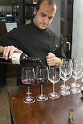pouring wine for tasting  Restaurant La Garrocha Valladolid spain castile and leon