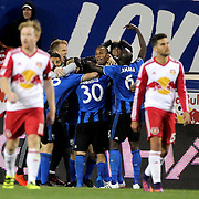 HARRISON, NEW JERSEY- November 06:  Didier Drogba #11 of Montreal Impact and goalscorer Ignacio Piatti #10 of Montreal Impact are mobbed by team mates after Montreal's second goal during the New York Red Bulls Vs Montreal Impact MLS playoff match at Red Bull Arena, Harrison, New Jersey on November 06, 2016 in Harrison, New Jersey. (Photo by Tim Clayton/Corbis via Getty Images)