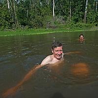 Gordon Wiltsie & Juan Carlos Palomino swim in the Yanayacu River in Peru's Amazon Jungle.