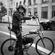 A man on his motorized bicycle makes his way down Hollywood Boulevard.