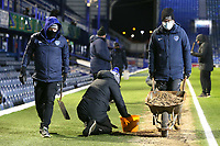 Football - 2020 / 2021 Sky Bet League One - Portsmouth vs. Swindon Town - Fratton Park<br /> <br /> Members of the Pompey Groundstaff tries to break up the frozen sand where the referee's assistant will be running the line at Fratton Park <br /> <br /> COLORSPORT/SHAUN BOGGUST
