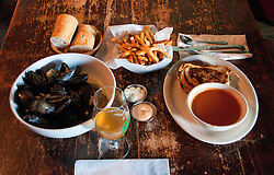Washington, DC: Food and drink at Granville Moore's restaurant/bar on H Street.  Photo copyright Lee Foster.  Photo #washdc106850.