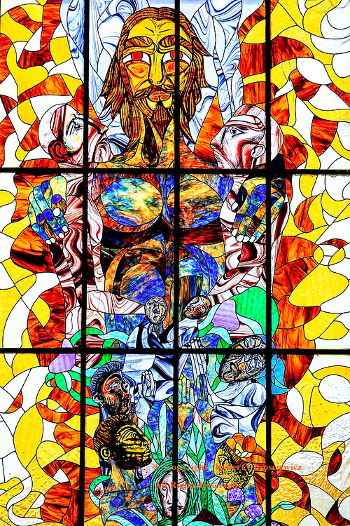Catholic Glass:This wonderful piece of stained glass art depicting Jesus and various biblical characters, graces the wall behind the alter of Iglesia de San Francisco de Paula, Havana Cub.