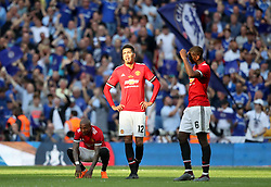 Manchester United's Ashley Young (left), Chris Smalling (centre) and Paul Pogba look dejected after the game