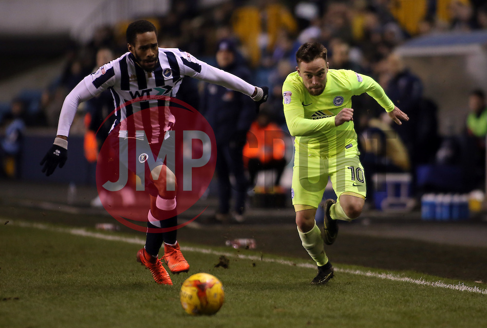 Paul Taylor of Peterborough United gets away from Shaun Cummings of Millwall - Mandatory by-line: Joe Dent/JMP - 28/02/2017 - FOOTBALL - The Den - London, England - Millwall v Peterborough United - Sky Bet League One
