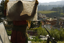 October 4, 2018 - Kathmandu, Nepal - A Nepalese woman carry a traditional Lokta paper to color and dry it for a product design at a production factory on the outskirts of Kathmandu, Nepal on Thursday, October 4, 2018. (Credit Image: © Skanda Gautam/ZUMA Wire)