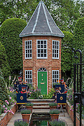 A military band plays in front of the Harrods British Eccentrics Garden by Diarmuid Gavin - as the sun rises.