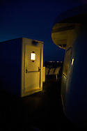 Night-time on the deck of M/V Nantucket, returning to Hyannis Harbor. The lights of West Yarmouth are visible in the distance.