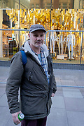 A portrait of photographer Dougie Wallace in Oxford Street, on 5th February 2021, in London, England.