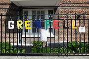 Brightly coloured Grenfell lettering on 17th June 2017 in North Kensington, London, United Kingdom. The Grenfell Tower fire occurred on 14 June 2017 at the 24-storey Grenfell Tower block of public housing flats in North Kensington, Royal Borough of Kensington and Chelsea, West London. It caused at least 80 deaths and over 70 injuries yet the actual numbers have yet to be confirmed