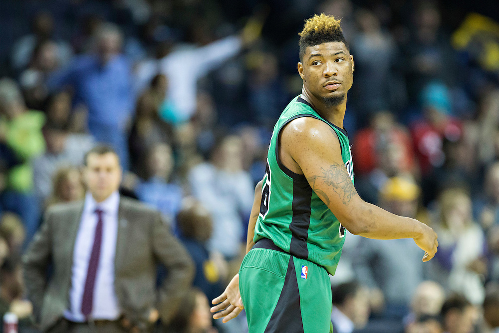 MEMPHIS, TN - JANUARY 10:  Marcus Smart #36 of the Boston Celtics walks down the court during a game against the Memphis Grizzles at the FedExForum on January 10, 2016 in Memphis, Tennessee.  The Grizzlies defeated the Celtics 101-98.  NOTE TO USER: User expressly acknowledges and agrees that, by downloading and or using this photograph, User is consenting to the terms and conditions of the Getty Images License Agreement.  (Photo by Wesley Hitt/Getty Images) *** Local Caption *** Marcus Smart
