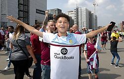 An Aston Villa fan outside Wembley during the Sky Bet Championship Final at Wembley Stadium, London.